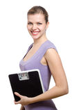 Smiling young woman holding a weight scale Stock Images