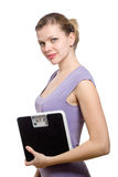 Smiling young woman holding a weight scale Royalty Free Stock Image