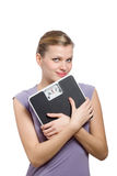 Smiling young woman holding a weight scale royalty free stock photos