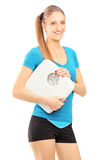 Smiling young woman holding weight scale Royalty Free Stock Image