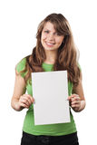Smiling young woman holding a white blank card. Cheerful smiling young woman is holding a white blank card. She is isolated on white background Stock Image
