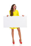 Smiling Young Woman Holding White Placard Stock Images
