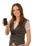 Smiling young woman holds mobile phone Stock Photos