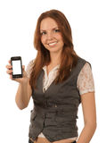 Smiling young woman holds mobile phone Stock Images