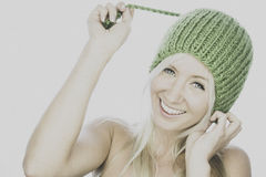 Smiling young woman with home knitted beanie Royalty Free Stock Images