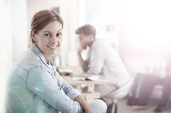 Smiling young woman at home with roommate Stock Images
