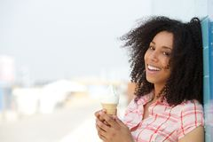 Smiling young woman with ice cream Royalty Free Stock Images