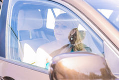 Smiling Young Woman Inside of the Car Royalty Free Stock Image