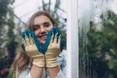 Happy female gardener in plant nursery Royalty Free Stock Image