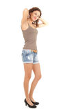 Smiling young woman in jeans shorts Royalty Free Stock Photography