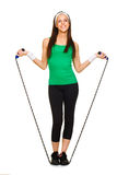 Smiling young woman with jump rope Royalty Free Stock Photo