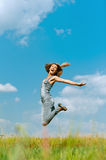 Smiling young woman jumping Stock Image