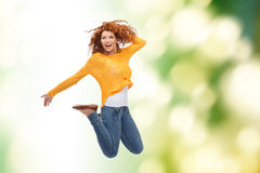 Smiling young woman jumping in air Royalty Free Stock Images