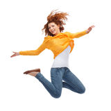 Smiling young woman jumping in air Royalty Free Stock Image