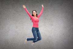 Smiling young woman jumping in air Royalty Free Stock Photography