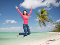 Smiling young woman jumping in air Royalty Free Stock Photo