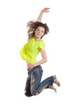 Smiling young woman jumping Royalty Free Stock Image