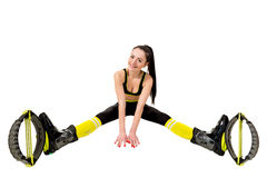 Smiling young woman in a kangoo jumps shoes sitting  legs apart. Stock Images