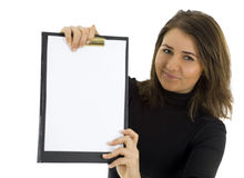 Smiling young woman keeping blank clipboard Stock Photography