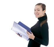 Smiling young woman keeping blue clipboard Royalty Free Stock Photography