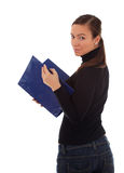 Smiling young woman keeping blue clipboard Stock Image