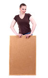 Smiling young woman keeping cork board Royalty Free Stock Photos