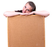Smiling young woman keeping cork board Royalty Free Stock Photo