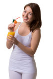 Smiling young woman keeps in hands a glass of orange juice. Smiling young woman keeps in hands a glass of orange juice on white isolated background Stock Photos