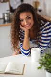 Smiling young woman in the kitchen,  on Stock Photos