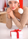Smiling young woman in the kitchen,  on christmas background Stock Images