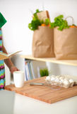 Smiling young woman in the kitchen, isolated on Stock Photo