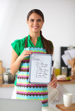 Smiling young woman in the kitchen, isolated on Stock Image