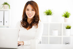 Smiling Young  woman  with laptop Stock Image