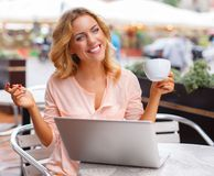 Smiling young woman with laptop Royalty Free Stock Photo