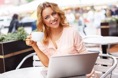 Smiling young woman with laptop Stock Photography