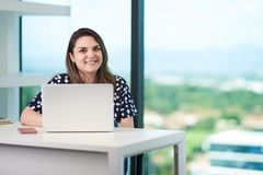 Smiling young woman with laptop stock photos