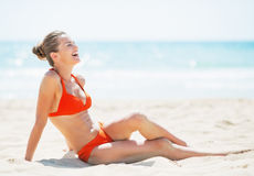 Smiling young woman laying on beach Royalty Free Stock Images