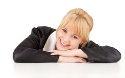 Smiling young woman leaning on the table Stock Photography