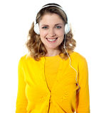 Smiling young woman listening music in headphones Stock Photo