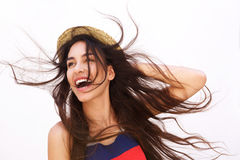 Smiling young woman with long hair blowing in the wind Royalty Free Stock Photo