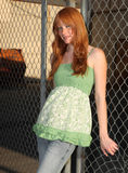 Smiling Young Woman With Long Red Hair Outdoors stock photo