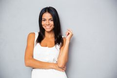 Smiling young woman looking at camera Royalty Free Stock Photos