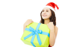 Smiling young woman looking forward with christmas gift box Royalty Free Stock Photo