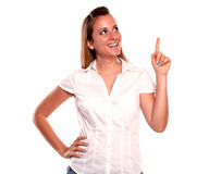 Smiling young woman looking and pointing up Royalty Free Stock Photos