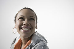 Smiling Young Woman Looking UP Royalty Free Stock Images