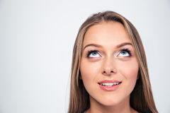 Smiling young woman looking up Stock Images