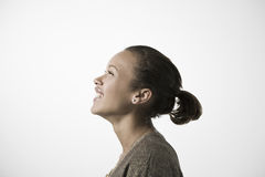 Smiling Young Woman Looking UP Stock Photo