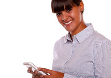 Smiling young woman looking at you with cellphone Stock Photography