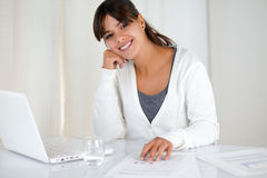 Smiling young woman looking at you at office Stock Photos