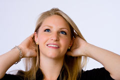 Smiling young woman looks up. Royalty Free Stock Photos